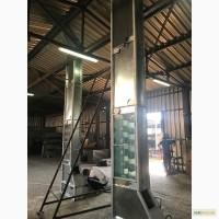 Нория - вертикальный ковшевой конвейер