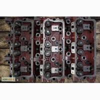 Головка блока цилиндров к двигателю СМД-23 (23-06С9) клапанированная