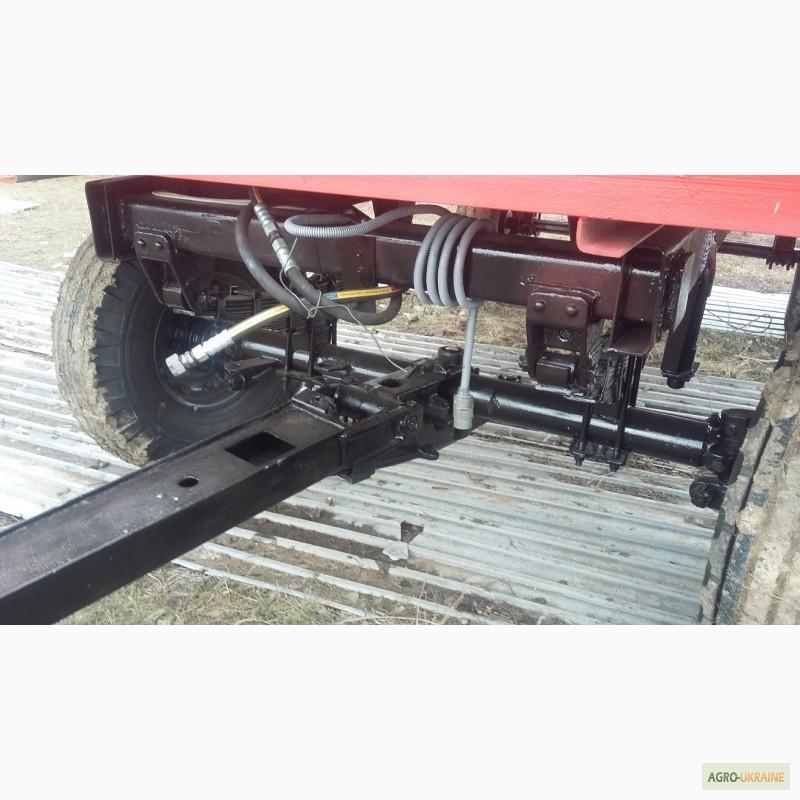 интерьере поворотный механизм тракторной телеги фото черных очках, костюме